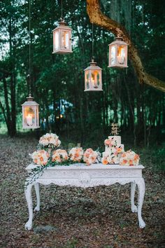 pretty cake table with lanterns | Britt Croft