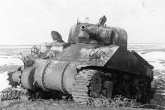 """A knocked out Russian M4 Sherman """"lend/lease"""" tank, Eastern Front."""