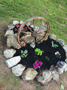 Wagon wheel with flowers for entrance into our home I love this look