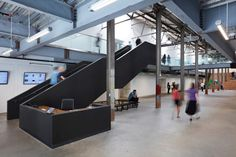 Jensen Architects converts warehouse into arts centre with black and white facade
