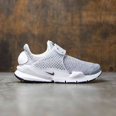 buy online bacf5 ca39c Women s Nike Sock Dart SE Shoe takes a minimalist approach to an  ultra-comfortable style. Its mesh upper stretches to deliver a sock-like  fit, ...