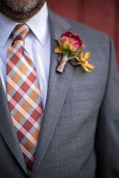 Go with deep colors for a fall wedding! Deep red, burnt orange and golden yellow totally pop against this groom's gray suit {Like A Dream Photography}