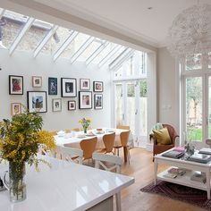 Nice to have family pics by dining area White open-plan kitchen space | Kitchen decorating | housetohome.co.uk