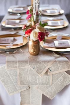 Book page table runner and mason jar centerpiece holders. Love this DIY tablescape! {Photo by Morgan Trinker via Project Wedding}