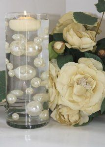 Clear water pearls with decorative pearls in between to make it look like they're floating