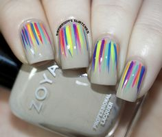 Contrast is your friend with these easy peazy summer stripes made by a quick flick of a nail art brush. As a fair skinned girl I would pick a slightly different base shade though, looks too pale for my taste.