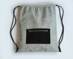 Handcrafted drawstring backpack made from grey linen/ viscose blend with black and mint speckles and delicate golden sparkle, adjustable handles and black suede pocket with metal zipper on the front. It is lined with a gorgeous cosmos map fabric. This wonderful simple backpack is multipurpose. Its perfect for carrying books and school stuff, as a bag for picnics and riding bike, like a swim or gym bag.. Size: 31 cm width, 38 cm height. Sewed by me in a non-smoking environment. ~~~~~~...