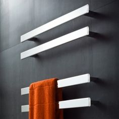 Designed by Avenir exclusively for Rogerseller, the Fold Single 750 Heated Towel Rails, with a minimalistic streamlined appeal, represents a new generation in heated towel ladders which offer flexibility in the number and positioning of the rails. Small Basement Bathroom, Add A Bathroom, Bathroom Plumbing, Modern Bathroom, Bathroom Fixtures, Bathroom Towel Storage, Bathroom Towels, Bathroom Laundry, Bathroom Stuff