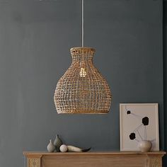 sea grass pendant, west elm, $89  maybe over night stands?