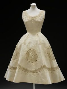 Evening dress Place of origin: Paris, France (made) Date: 1950-1955 (made) Artist/Maker: Pierre Balmain, born 1914 - died 1982 (designer) Materials and Techniques: Silk grosgrain with embroidery, lined with linen, supported by boning and net Credit Line: Given by Mrs G. Sachet