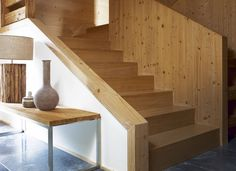 Neutral Hallway with Pine Staircase and Stone Flooring