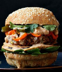 Red Lentil Cauliflower Burger with Chipotle Habanero Mayo, Onion Rings, Roasted peppers.