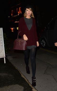 Taylor Swift looked so cool wearing a pretty maroon cardigan and gray sweater with a matching bag while visiting the Saatchi Gallery in London.
