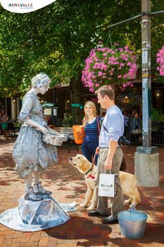 The Silver Drummer Girl on Pack Square in AVL ... The Asheville arts scene is buzzing, featuring hundreds of fine artists, performing arts venues, mountain crafters, folk artists, hip arts neighborhoods, numerous art galleries and myriads of art events ... just more of the many charms of Asheville.