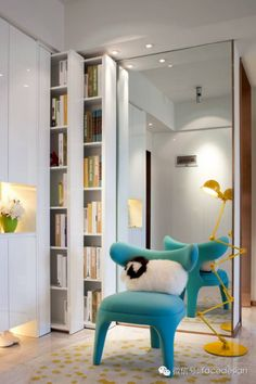 Chair, yellow lamp, ram kidney pillow