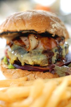 "he juicy ""Aussie"" burger, complete with Bacon, Cheese and Beetroot"