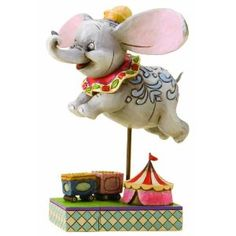 Stef u will love this one also its ur favorite:) Disney Traditions by Jim Shore 4010028 Dumbo Personality Pose Figurine 4-1/2-Inch