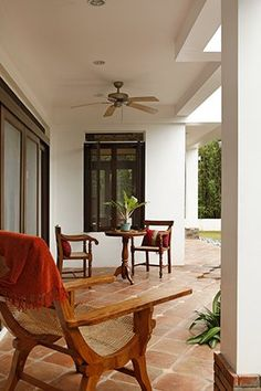 Filipino Home Styling. The lanai has Vigan tiles and a number of antique chairs, including a butaca (armchair). Tropical Houses, Modern Tropical, Tropical Design, Filipino Architecture, Tropical Architecture, Modern Filipino House, Filipino Interior Design, Modern Mediterranean Homes, Filipiniana