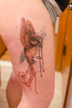 Watercolor bird thigh tattoo-- MINE! Thanks Greg Pramik!