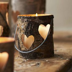 Gorgeous tree trunk heart candle holders!