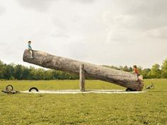 seesaw-This reminds me of my childhood: using a rusty old grain auger as a seesaw.