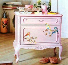 Soft pink painted nightstand with painted bird