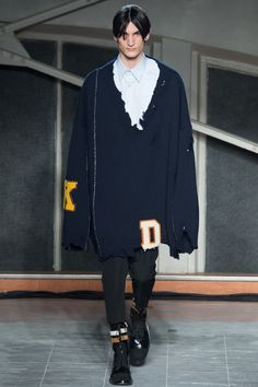 """""""Raf Simons: The best menswear collection of the season, from the best menswear designer in the world. I couldn't choose a favorite look from this collection. I chose the first, because I'd like you to go and click through all the others. A great chewed-up chunk of references, from Twin Peaks to Martin Margiela to Cindy Sherman's Untitled Horrors, all spit up on a giant letterman sweater that looks like something we all may once have owned, but simultaneously like nothing else on earth…"""