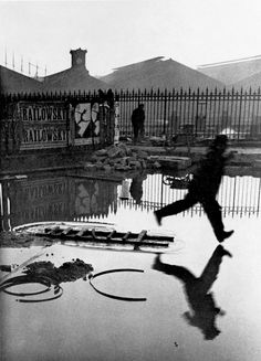 Henri Cartier-Bresson - Behind The Gare Saint-Lazare, 1932 n amazing image...apparently he says he stuck the camera through a gap in the fence and took the shot without seeing what was on the other side!