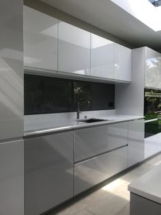 Kitchen and bathroom glass splashbacks (splash backs): modern design, hard wearing, they accentuate the natural light in a room. We work across all of London and Kent areas, fitting glass into homes and commercial properties. Grey Kitchen Interior, Modern Grey Kitchen, Small Modern Kitchens, Kitchen Room Design, Custom Kitchens, Home Room Design, Kitchen Cabinet Design, Modern Kitchen Design, Kitchen Layout