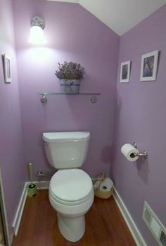 ive been trying to figure out what to do with our #lavendar #bathroom downstairs. I love the bucket and small frames!