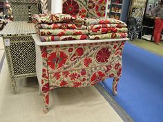 An upholstered dresser covered in Indian embroidered textiles from Mangalam Arts