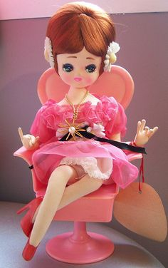 pose doll in pink dress