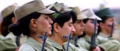 Iraqi Kurd women volunteer fighters (Peshmerga) hold their arms during a daily military training at the Suleimaniya general command base in a suburb of the Patriotic Union of Kurdistan (PUK)-controlled city of Suleimaniya, some 250 kms north-east of Baghdad, 30 October 2002. (Photo: Behrouz Mehri/AFP/Getty Images)