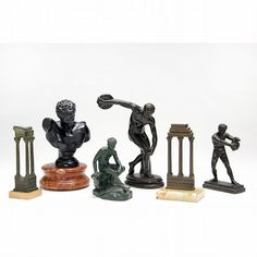 Group of Miniature Grand Tour Bronzes, circa 1900, including a bust on stone base, (2) architectural ruins on stone bases, (2) disc throwers (one is metal over composite), and Achilles.Tallest 7.5 in.Ex.