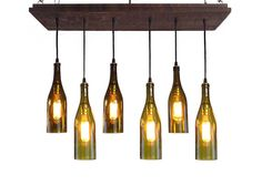 6 Wine Bottle Pendant Chandelier - Rustic Lighting Unique rustic style Wine Bottle Chandelier. The wood base is stained a rich walnut brown color. Wiring is black with antique gilt hardware and sockets. Six cascading recycled wine bottle pendants. DETAILS Base: 9.25 x 30 with frame Finish: We offer 9 different color options - Refer to Base Color Cart Picture Sockets: antique gilt Cord: Basic black 6 Wine Bottle Pendants (olive, amber) The longest bottle hangs 22 from the base. 40w Bulb max…