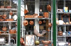 Copper Cookware in a Parisian storefront | www.WithTheGrains.com