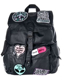 PU False Leather mini backpack. Front pouch pocket. 2 side pockets. Drawstring closure with buckled flap. 7 cotton embroidered patches. TAG YOUR PURCHASE: #disturbiaclothing IN STOCK & SHIPS WITHIN 24 HOURS