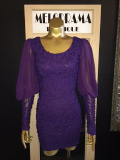 Textured sheer sleeve dress. Available in purple and dusty rose.