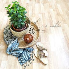 Beautify your home with edible plants. Bay leaf, Laurus nobilis. Rene Caovilla Swarovski sandals. Indigo blue batik. Balinese coconut shell. Bamboo rice tray.