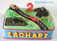 It's like this was destined to be Zachary's birthday theme! I found a cake with his name even!! Transportation Birthday Cake/Car, Truck, Tractor and 4-Wheeler