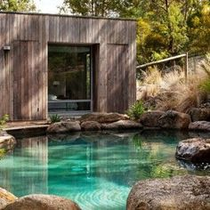 Eltham South basalt boulder swimming pool #PoolLandscaping