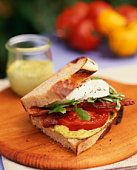 Bacon, Lettuce and Tomato Sandwich  Try adding some fresh mozzarella with basil pesto and balsamic vinegar to your regular BLT recipe.  Then spread garlic butter on the outside breads and grill paninni style!  YUMMMMMYYYYY!
