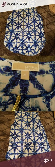 Blue and White Michael Kors Tank Top Cute zip down Michael Kors tank top. Only worn once.  Great quality and perfect for summer. Tank top does have very small hole where the price tag was attached as shown in the second picture. Willing to take offers. Michael Kors Tops Tank Tops