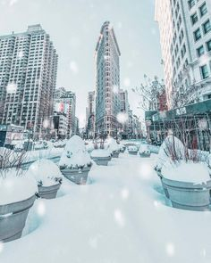 Flatiron under snow by nycprimeshot #NYC - The Best Photos and Videos of New York City including the Statue of Liberty, Brooklyn Bridge, Central Park, Empire State Building, Chrysler Building and other popular New York places and attractions.