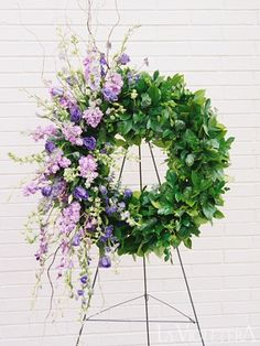 This unique funeral wreath pairs the elegance and show of long lavender flowers with the simplicity of green foliage. Arrangements Funéraires, Funeral Floral Arrangements, Diy Sympathy Flower Arrangements, Ikebana, Casket Flowers, Funeral Flowers, Funeral Sprays, Casket Sprays, Funeral Tributes