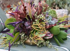 How to make Succulent Centerpieces.  They last a month, then plant ones that grew roots