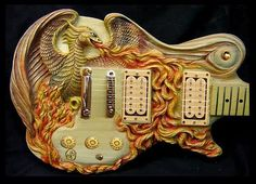 Hand carved Guitars.... yep.