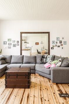 big, inviting seating. also love the photo groupings on the walls behind.