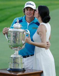 Stone-faced Jason Dufner manages a grin as he receives a kiss from wife Amanda after winning the PGA Championship. A two-stroke victory over Jim Furyk brings Dufner his first major title. (Charlie Neibergall/AP)  Learn more Dufner delivers Auburn celebrates  Final leaderboard  Furyk second again