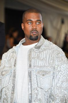 A couture denim jacket by Balmain and contact lenses straight from the retro beauty archives. Kanye West nodded to 00s beauty trends on the Met Gala red carpet and we salute him for it.